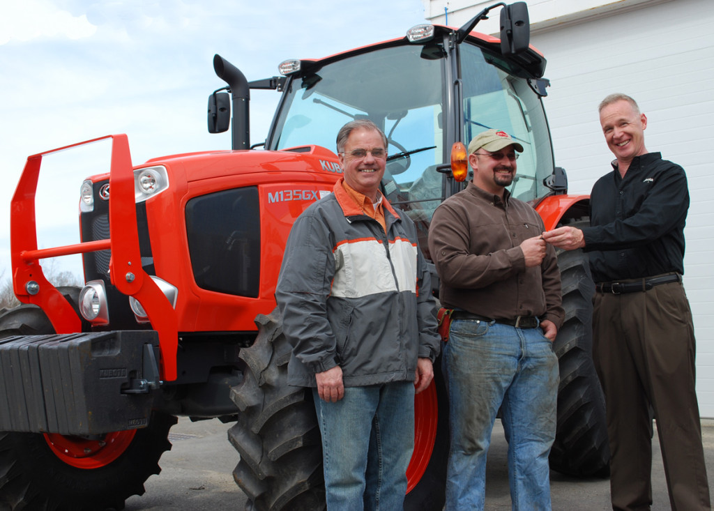 Kubota Regional Sales Manager for New England Larry Curran (right) hands the tractor keys to the 2013 Young Farmer Achievement Award winner Trevor Hardy (center) with Mike Snide (left) of Pinnacleview Equipment in Walpole.  Special thanks to Pinnacleview Equipment and Kubota for their continued support to the New Hampshire Young Farmer program.