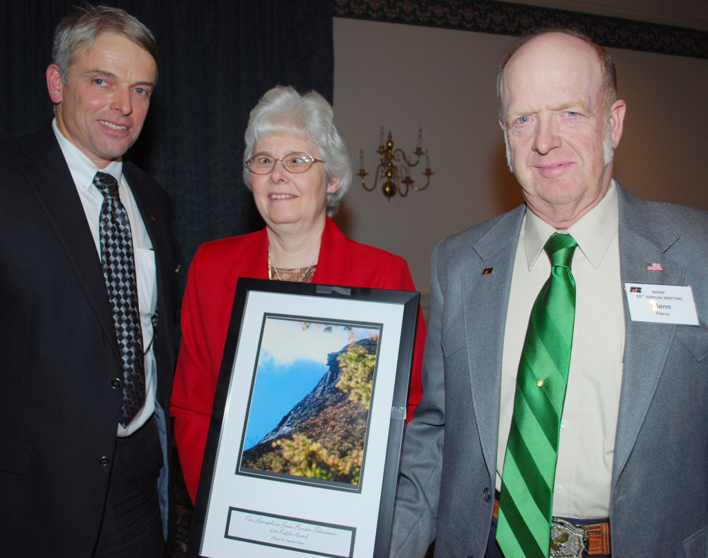 New Hampshire Farm Bureau President Jeff Holmes (left) presented Glenn and Sandra Pierce of Strafford with the 2014 Profile Award.